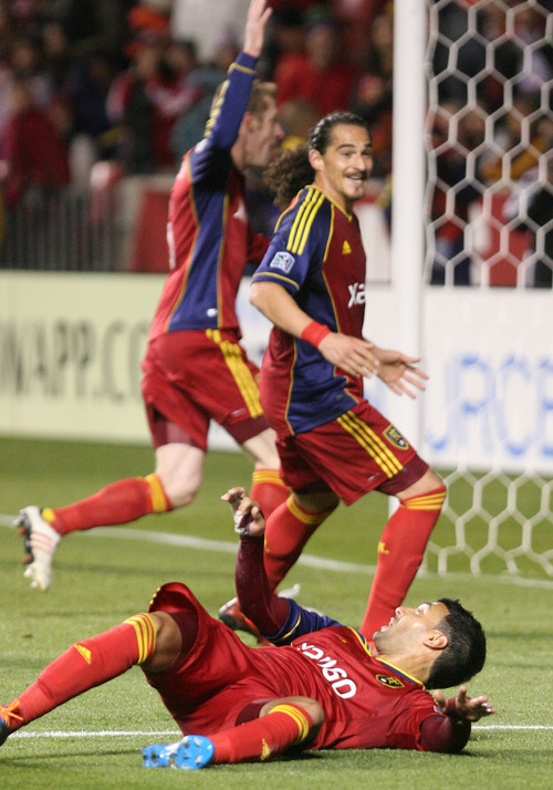 Leah Hogsten  | The Salt Lake Tribune Real Salt Lake midfielder Javier Morales (11) and his teammates celebrates his goal. Real Salt Lake defeated the Portland Timbers 4-2  during their first leg of the Western Conference final series Sunday, November 10, 2013 at Rio Tinto Stadium.