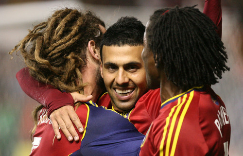 Leah Hogsten  |  The Salt Lake Tribune Real Salt Lake midfielder Javier Morales (11) celebrates his 2nd half goal with teammates Real Salt Lake midfielder Kyle Beckerman (5) andReal Salt Lake midfielder/defender Lovel Palmer (7). Real Salt Lake defeated the Portland Timbers 4-2  during their first leg of the Western Conference final series Sunday, November 10, 2013 at Rio Tinto Stadium.