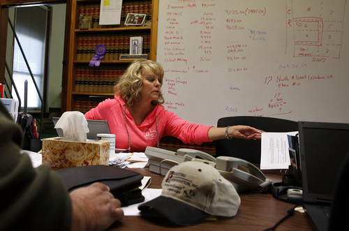 In this Nov. 6, 2013 photo, Washington County Commissioner Lea Ann Laybourn works in her office in the rural town of Akron, the county seat of Washington County, Colo. A day earlier, a majority in Washington and four other counties on Colorado's Eastern Plains voted yes on the creation of a 51st state, largely over residents' alienation from voters statewide on issues such as civil unions for gay couples, new renewable energy standards, and limits on ammunition magazines. (AP Photo/Brennan Linsley)