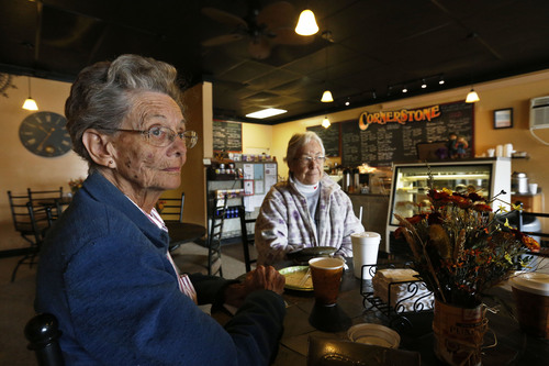 In this Nov. 6, 2013 photo, Pearl Gasser, age 80, sits with her friend Velma Drumtalk, at the Cornerstone Cafe, in the rural town of Akron, the county seat of Washington County, Colo. A day earlier, a majority in Washington and four other counties on Colorado's Eastern Plains voted yes on the creation of a 51st state, largely over residents' alienation from voters statewide on issues such as civil unions for gay couples, new renewable energy standards, and limits on ammunition magazines. (AP Photo/Brennan Linsley)