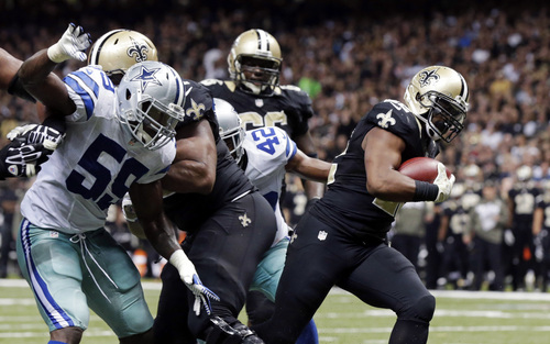 New Orleans Saints running back Mark Ingram, right, carries into the end zone in front of Dallas Cowboys inside linebacker Ernie Sims (59) and free safety Barry Church (42) on a touchdown carry in the second half of an NFL football game in New Orleans, Sunday, Nov. 10, 2013. (AP Photo/Dave Martin)