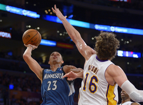 Minnesota Timberwolves guard Kevin Martin, left, puts up a shot as Los Angeles Lakers center Pau Gasol, of Spain, defends during the second half of an NBA basketball game, Sunday, Nov. 10, 2013, in Los Angeles. (AP Photo/Mark J. Terrill)