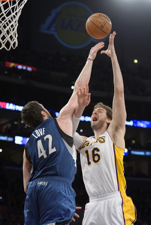 Los Angeles Lakers center Pau Gasol, right, of Spain, puts up a shot as Minnesota Timberwolves forward Kevin Love defends during the first half of an NBA basketball game, Sunday, Nov. 10, 2013, in Los Angeles. (AP Photo/Mark J. Terrill)