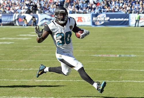 Jacksonville Jaguars running back Jordan Todman scores a touchdown on a 5-yard run against the Tennessee Titans in the third quarter of an NFL football game on Sunday, Nov. 10, 2013, in Nashville, Tenn. (AP Photo/Mark Zaleski)