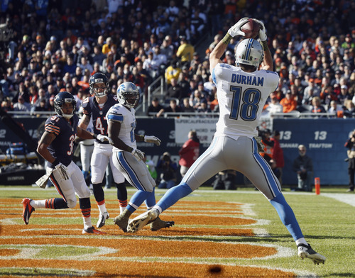 Detroit Lions wide receiver Kris Durham (18) makes a touchdown reception during the first half of an NFL football game against the Chicago Bears, Sunday, Nov. 10, 2013, in Chicago. (AP Photo/Charles Rex Arbogast)