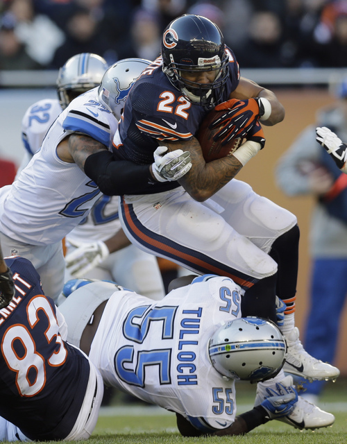 Chicago Bears running back Matt Forte (22) rushes against Detroit Lions safety Glover Quin, left, and linebacker Stephen Tulloch (55) during the second half of an NFL football game, Sunday, Nov. 10, 2013, in Chicago. (AP Photo/Nam Y. Huh)