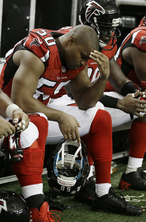 Atlanta Falcons defensive end Osi Umenyiora (50) sits on the bench during the second half of an NFL football game against the Seattle Seahawks, Sunday, Nov. 10, 2013, in Atlanta. Seattle Seahawks won 33-10. (AP Photo/John Bazemore)