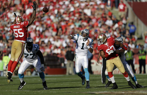 Carolina Panthers quarterback Cam Newton (1) passes as San Francisco 49ers linebacker Ahmad Brooks (55) tries to deflect the ball during the third quarter of an NFL football game in San Francisco, Sunday, Nov. 10, 2013. (AP Photo/Marcio Jose Sanchez)