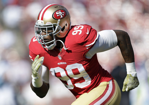 San Francisco 49ers linebacker Aldon Smith (99) warms up before an NFL football game against the Carolina Panthers in San Francisco, Sunday, Nov. 10, 2013. (AP Photo/Marcio Jose Sanchez)