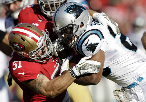 Carolina Panthers running back Jonathan Stewart, right, is tackled by San Francisco 49ers linebacker Dan Skuta during the second quarter of an NFL football game in San Francisco, Sunday, Nov. 10, 2013. (AP Photo/Marcio Jose Sanchez)