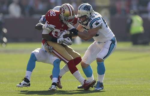 San Francisco 49ers wide receiver Mario Manningham (82) is tackled by Carolina Panthers cornerback Captain Munnerlyn, rear, and middle linebacker Luke Kuechly during the first quarter of an NFL football game in San Francisco, Sunday, Nov. 10, 2013. (AP Photo/Ben Margot)