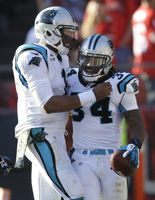 Carolina Panthers running back DeAngelo Williams (34) celebrates with quarterback Cam Newton after running for a 27-yard touchdown against the San Francisco 49ers during the second quarter of an NFL football game in San Francisco, Sunday, Nov. 10, 2013. (AP Photo/Ben Margot)