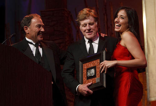 "Leah Hogsten  |  The Salt Lake Tribune l-r Governor Gary Herbert and Robert Redford share a laugh as he is presented a gift from Herbert. For all his contributions to the state of Utah, Robert Redford was recognized and honored by Governor Gary Herbert at a gala in his honor, ""The Governor's Salute to Robert Redford: A Utah Tribute to an American Icon"" at the Grand America Hotel, Saturday, November 9, 2013. Redford is an actor, director, producer, philanthropist, businessman, environmentalist, and founder of the Sundance Resort, the Sundance catalog, and the Sundance Institute which hosts the Sundance Film Festival."