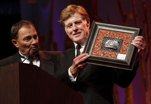 "Leah Hogsten  |  The Salt Lake Tribune l-r Governor Gary Herbert presents Robert Redford a gift. For all his contributions to the state of Utah, Robert Redford was recognized and honored by Governor Gary Herbert at a gala in his honor, ""The Governor's Salute to Robert Redford: A Utah Tribute to an American Icon"" at the Grand America Hotel, Saturday, November 9, 2013. Redford is an actor, director, producer, philanthropist, businessman, environmentalist, and founder of the Sundance Resort, the Sundance catalog, and the Sundance Institute which hosts the Sundance Film Festival."