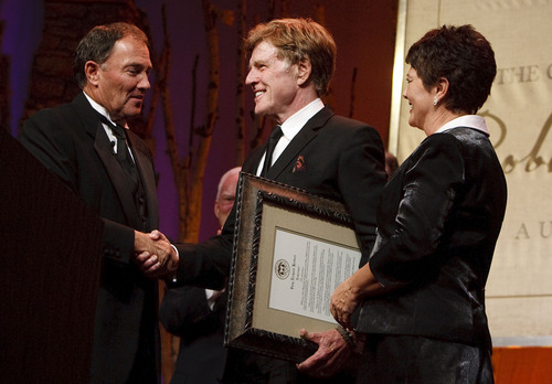 "Leah Hogsten  |  The Salt Lake Tribune Gov. Gary Herbert and his wife, Jeanette, present Robert Redford with the declaration that November 9, 2013 is Robert Redford Day. For all his contributions to the state of Utah, Robert Redford was recognized and honored by Governor Gary Herbert at a gala in his honor, ""The Governor's Salute to Robert Redford: A Utah Tribute to an American Icon"" at the Grand America Hotel, Saturday, November 9, 2013. Redford is an actor, director, producer, philanthropist, businessman, environmentalist, and founder of the Sundance Resort, the Sundance catalog, and the Sundance Institute which hosts the Sundance Film Festival."