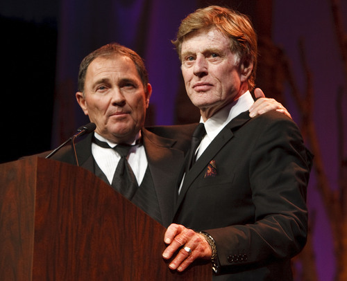 "Leah Hogsten  |  The Salt Lake Tribune l-r Governor Gary Herbert introduces Robert Redford. For all his contributions to the state of Utah, Robert Redford was recognized and honored by Governor Gary Herbert at a gala in his honor, ""The Governor's Salute to Robert Redford: A Utah Tribute to an American Icon"" at the Grand America Hotel, Saturday, November 9, 2013. Redford is an actor, director, producer, philanthropist, businessman, environmentalist, and founder of the Sundance Resort, the Sundance catalog, and the Sundance Institute which hosts the Sundance Film Festival."