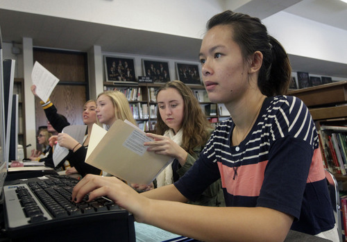Al Hartmann  |  The Salt Lake Tribune Cottonwood High School senior Tammy Tran applies online to Westminster College Monday November 11.  Hundreds of seniors applied during College Application Week.