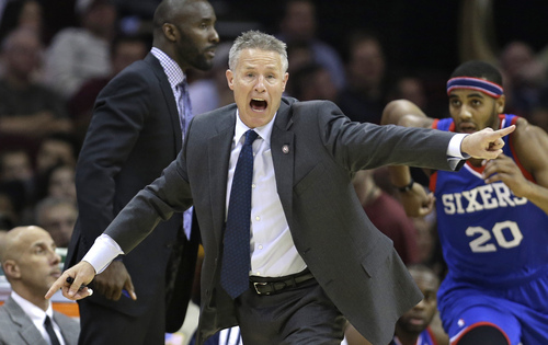 Philadelphia 76ers coach Brett Brown points during the second quarter of an NBA basketball game against the Cleveland Cavaliers on Saturday, Nov. 9, 2013, in Cleveland. The Cavaliers won 127-125 in double overtime. (AP Photo/Tony Dejak)