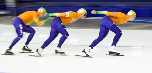 Koen Verweij, right, of the Netherlands, leads teammates, Jan Blokhuijsen, center, and Sven Kramer, to a new World record in the men's team pursuit competition at the World Cup speed skating event in Calgary, Alberta, Saturday, Nov. 9, 2013.  The Netherlands had a time of 3:37.17, breaking the mark of 3:37.80 set in Salt Lake City in 2007. (AP Photo/The Canadian Press, Jeff McIntosh)