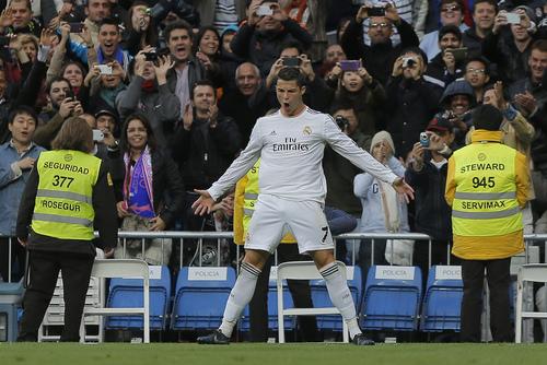 Real Madrid's Cristiano Ronaldo celebrates his third goal during a Spanish La Liga soccer match between Real Madrid and Real Sociedad at the Santiago Bernabeu stadium in Madrid, Spain, Saturday, Nov. 9 , 2013. (AP Photo/Andres Kudacki)