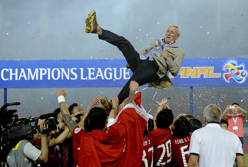 China's Guangzhou Evergrande players throw their coach Marcello Lippi into the air after winning the final match against South Korea's FC Seoul at the 2013 Asian Champions League final at Tianhe stadium in Guangzhou in south China's Guangdong province, Saturday, Nov. 9, 2013. Guangzhou Evergrande became the first Chinese team since 1990 to win the Asian Champions League by drawing 1-1 with FC Seoul in the second leg of the final on Saturday, claiming the title on away goals after the first game in South Korea ended 2-2. (AP Photo) CHINA OUT