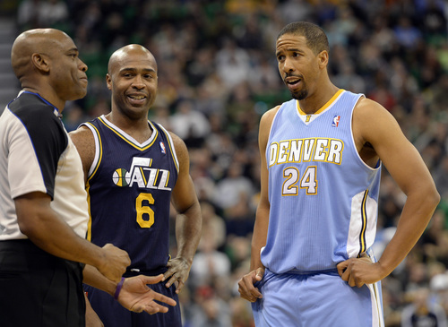 Rick Egan  | The Salt Lake Tribune   Utah Jazz point guard Jamaal Tinsley (6) and Denver Nuggets point guard Andre Miller (24) talk with referee Tre Maddox (73) in NBA action, Utah vs. The Denver Nuggets, in Salt Lake City, Monday, November 11, 2013.