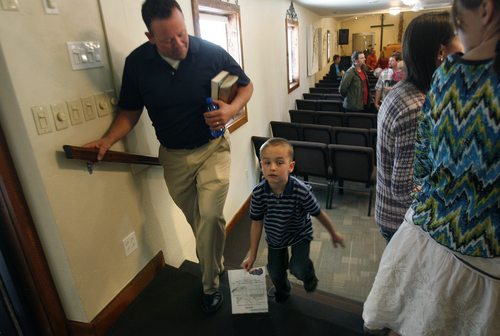 Scott Sommerdorf   |  The Salt Lake Tribune Former Utah legislator Carl Wimmer leaves Sunday services with his son Reagan, 6, at Ephraim Church of the Bible, Sunday, Oct. 27, 2013.