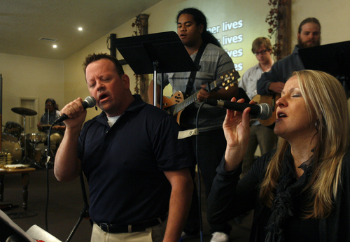 "Scott Sommerdorf   |  The Salt Lake Tribune Former Utah lawmaker Carl Wimmer sings ""My Redeemer Lives"" alongside Carolyn Schanta during services at Ephraim Church of the Bible on Sunday, Oct. 27, 2013."