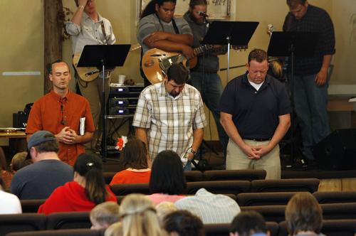 Scott Sommerdorf   |  The Salt Lake Tribune Former Utah lawmaker Carl Wimmer, right, prays as Pastor Rodney Zedicher, far left, gives the prayer prior to communion, Sunday, Oct. 27, 2013 at Ephraim Church of the Bible in Ephraim, Utah.