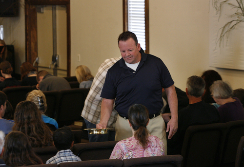 Scott Sommerdorf   |  The Salt Lake Tribune Former Utah lawmaker Carl Wimmer offers the communion juice to parishoners on Sunday, Oct. 27, 2013, at Ephraim Church of the Bible in Ephraim, Utah.
