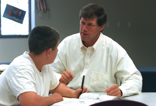 Tribune file photo  Former NFL star Todd Christensen and his son Teren, who suffers from spina bifida, take some time to solve jumble puzzles at the American Fork library in this 2001 photo.