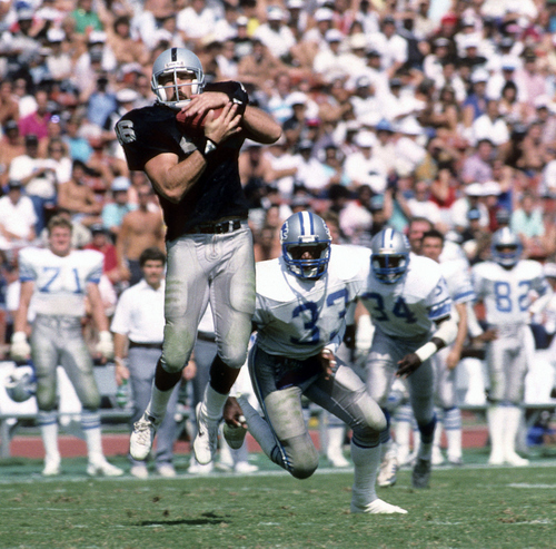 In this Sept. 20, 1997 photo provided by the NFL, Los Angeles Raiders tight end Todd Christensen (46) makes a grab during a 27-7 victory over the Detroit Lions at Los Angeles Memorial Coliseum in Los Angeles. Former Raiders tight end and five-time Pro Bowler Todd Christensen died from complications during liver transplant surgery. He was 57.  Christensen's son, Toby Christensen, said his father passed away Wednesday morning, Nov. 13, 2013,  at Intermountain Medical Center near his home in Alpine, Utah.  (AP Photo/NFL Photos)