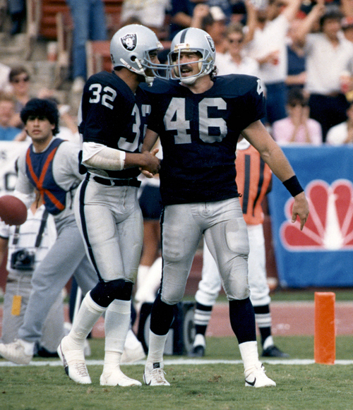 FILE - This Nov. 16, 1986 photo provided by the NFL shows Los Angeles Raiders tight end Todd Christensen (46) being congratulated by Marcus Allen (32) after scoring on a 3-yard touchdown reception during the Raiders 27-14 victory over the Cleveland Browns in Los Angeles. Former Raiders tight end and five-time Pro Bowler Todd Christensen died from complications during liver transplant surgery. He was 57.  Christensen's son, Toby Christensen, said his father passed away Wednesday morning, Nov. 13, 2013,  at Intermountain Medical Center near his home in Alpine, Utah. †(AP Photo/NFL Photos)