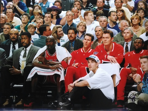 "Courtesy photo | Preston Truman Michael Jordan sits on the Chicago Bulls bench at the Delta Center during the ""Flu Game,"" in which he led the bulls to a 3-2 NBA Finals lead on June 11, 1997. Seated on the floor at right is former Utah Jazz ballboy Preston Truman."