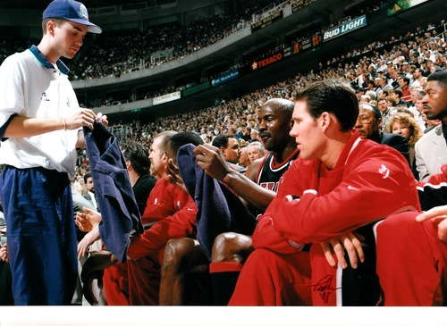 Courtesy of Preson Truman Former Utah Jazz ballboy Preston Truman hands Michael Jordan a towel for a regular-season game Feb. 4, 1998. It was Jordan's last regular-season visit to the Delta Center with the Bulls.