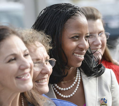 Al Hartmann  |  The Salt Lake Tribune Mia Love poses with volunteers for Fisher House, a home for family's of veterans undergoing healthcare at Salt Lake City's VA Hospital.  Earlier she held a town hall meeting with  former Congressman Allen West.