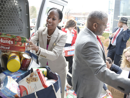 Al Hartmann  |  The Salt Lake Tribune Mia Love and former Congressman Allen West load donated food items to be delivered to Fisher House,  a home for family's of veterans undergoing healthcare at Salt Lake City's VA Hospital.  Earlier she held a town hall meeting with West.