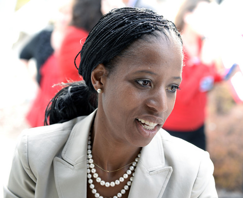 Al Hartmann  |  The Salt Lake Tribune Mia Love loads donated food items to be delivered to Fisher House,  a home for family's of veterans undergoing healthcare at Salt Lake City's VA Hospital.  Earlier she held a town hall meeting with West.