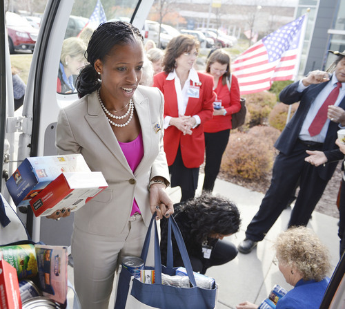 Al Hartmann  |  The Salt Lake Tribune Mia Love loads donated food items to be delivered to Fisher House,  a home for family's of veterans undergoing healthcare at Salt Lake City's VA Hospital.  Earlier she held a town hall meeting former Congressman Allen  West.