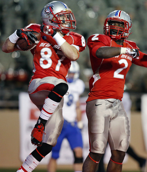 New Mexico's Jeric Magnant (87) celebrates his touchdown catch against Air Force with teammate Crusoe Gongbay (2) in the first half of an NCAA college football game on Friday, Nov. 8, 2013, in Albuquerque, N.M. (AP Photo/Ross D. Franklin)