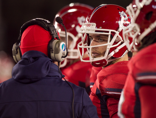 Fresno St quarterback Derek Carr (4) talks to coaching staff on the sideline during the first half of an NCAA college football game against Wyoming, Saturday, Nov. 9, 2013 at War Memorial Stadium in Laramie, WY.  (AP Photo/Jeremy Martin)