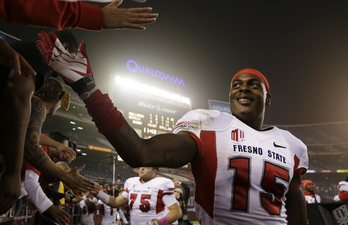Fresno State wide receiver Davante Adams, right, is greeted by fans after beating San Diego State in an NCAA college football game Saturday, Oct. 26, 2013, in San Diego. Fresno State won, 35-28. (AP Photo/Gregory Bull)