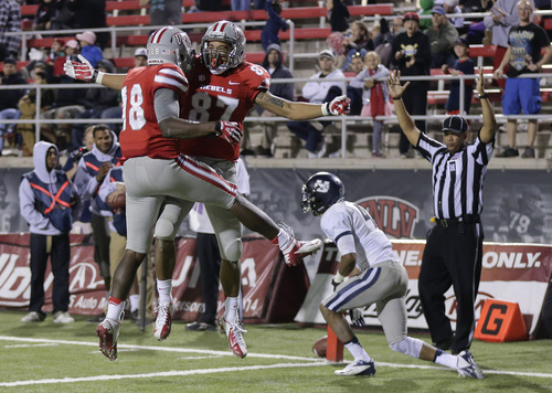 UNLV wide receiver Maika Mataele (87) celebrates with UNLV wide receiver Marcus Sullivan (18) after scoring a touchdown against Utah State in the fourth quarter of an NCAA college football game, Saturday, Nov. 9, 2013, in Las Vegas. Utah State won 28-24. (AP Photo/Julie Jacobson)