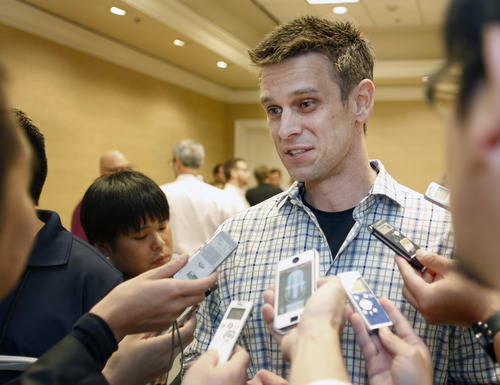 Los Angeles Angels general manager Jerry Dipoto talks with the media at the annual baseball general managers meeting, Tuesday, Nov. 12, 2013, in Orlando, Fla. (AP Photo/Reinhold Matay)