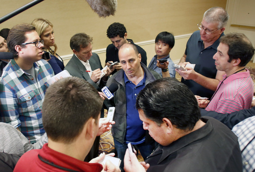 New York Yankees general manager Brian Cashman talks with the media at the annual baseball general managers meeting, Tuesday, Nov. 12, 2013, in Orlando, Fla. (AP Photo/Reinhold Matay)