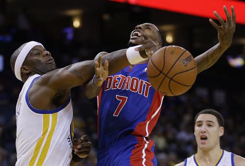 Golden State Warriors' Jermaine O'Neal, left, blocks the shot of Detroit Pistons' Brandon Jennings (7) during the first half of an NBA basketball game on Tuesday, Nov. 12, 2013, in Oakland, Calif. (AP Photo/Ben Margot)