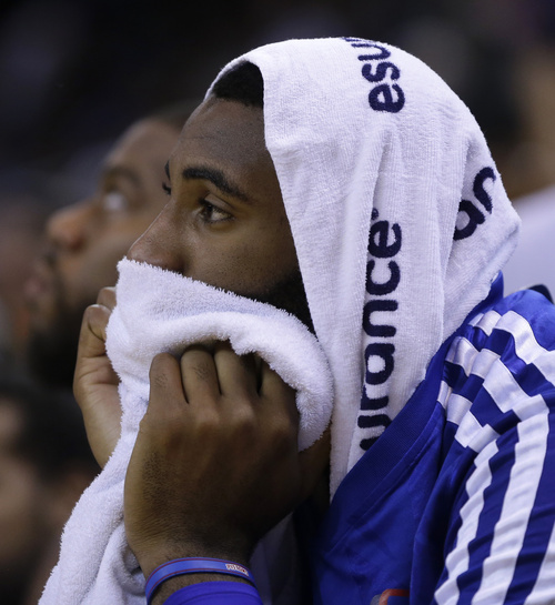 Detroit Pistons' Andre Drummond watches from the sideline during the first half of an NBA basketball game against the Golden State Warriors, Tuesday, Nov. 12, 2013, in Oakland, Calif. (AP Photo/Ben Margot)