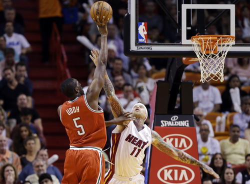Milwaukee Bucks' Ekpe Udoh (5) shoots as Miami Heat's Chris Andersen (11) defends during the first half of an NBA basketball game Tuesday, Nov. 12, 2013, in Miami. (AP Photo/Lynne Sladky)