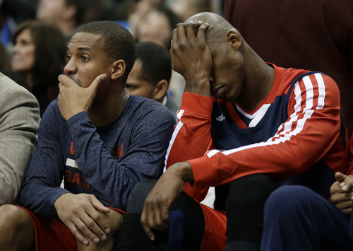 Washington Wizards' Garrett Temple, left, and Al Harrington, right, sit on the bench in the closing minutes of the Wizards' NBA basketball game against the Dallas Mavericks, Tuesday, Nov. 12, 2013, in Dallas. The Mavericks won 105-95. (AP Photo/Tony Gutierrez)