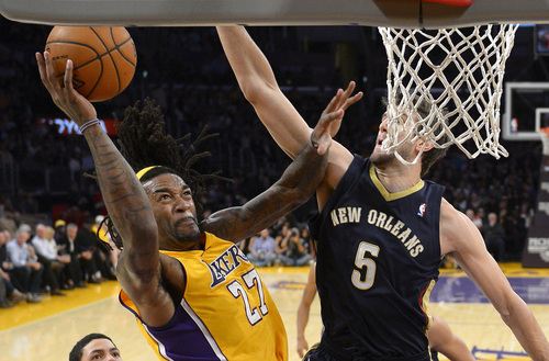 Los Angeles Lakers center Jordan Hill, left, puts up a shot as New Orleans Pelicans center Jeff Withey defends during the first half of an NBA basketball game, Tuesday, Nov. 12, 2013, in Los Angeles. (AP Photo/Mark J. Terrill)